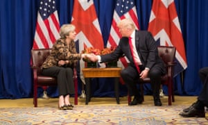 Donald Trump shakes hands with Theresa May at the UN general assembly