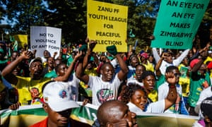 Activists from the youth arm of the ruling Zanu-PF party attend a rally in Harare, Zimbabwe