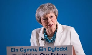 Theresa May speaking at the Welsh Conservative party conference at Llangollen Pavilion, where she was heckled by an activist saying she should resign.