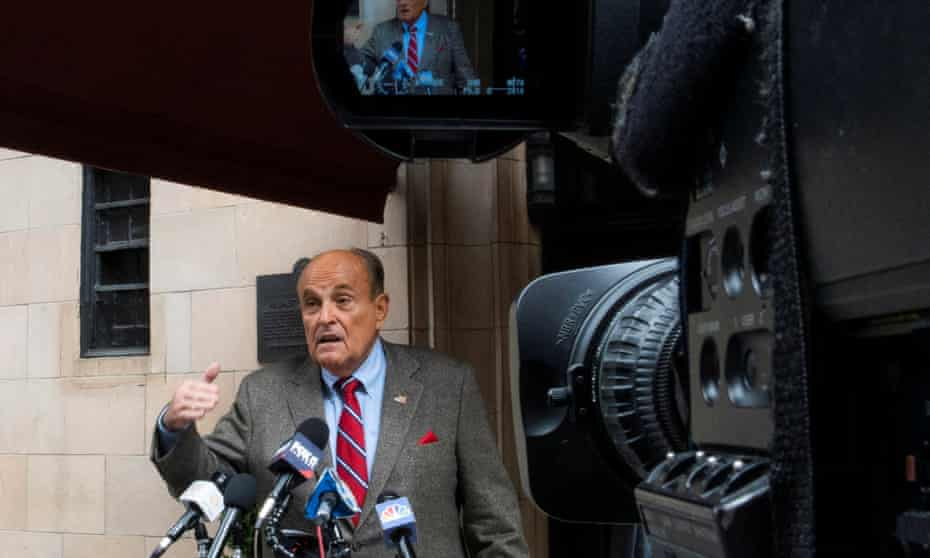 Rudy Giuliani speaks to the media outside his apartment building in New York City in August.