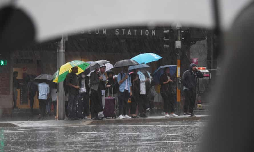 Pedestrians hold umbrellas during wet weather in Sydney