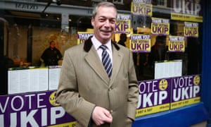 Nigel Farage poses for photographs outside the Ukip office in 2014.