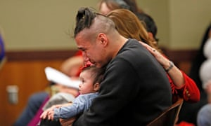 Savanna LaFontaine-Greywind's boyfriend Ashston Matheny holds their daughter, as victim impact statements are read during the sentencing of Brooke Crews.