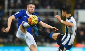 Everton's goalscorer, Tom Cleverley, high-kicking with Ayoze Perez.