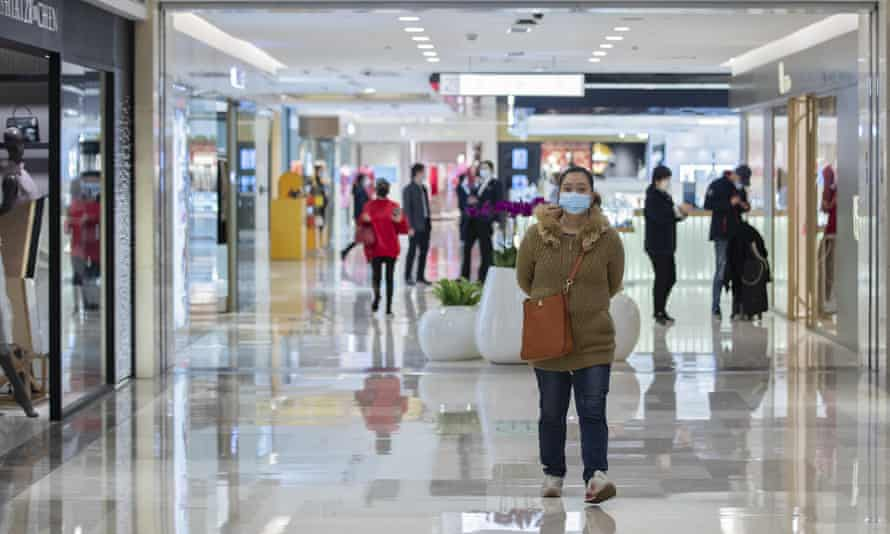 Shoppers in a newly reopened shopping centre in China