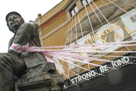 Pink ribbons wrapped round the Theatre Royal Stratford East, and its statue of director Joan Littlewood, in July.