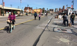 Detroit residents cycle and walk on the city's temporarily traffic-free streets