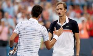 Novak Djokovic congratulates Daniil Medvedev after the Russian produced an impressive comeback to win their semi-final in Cincinnati.