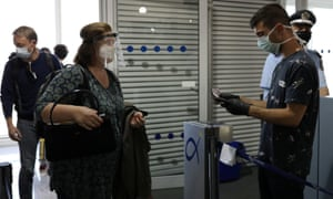 Passengers arrive at Athens airport, Greece.