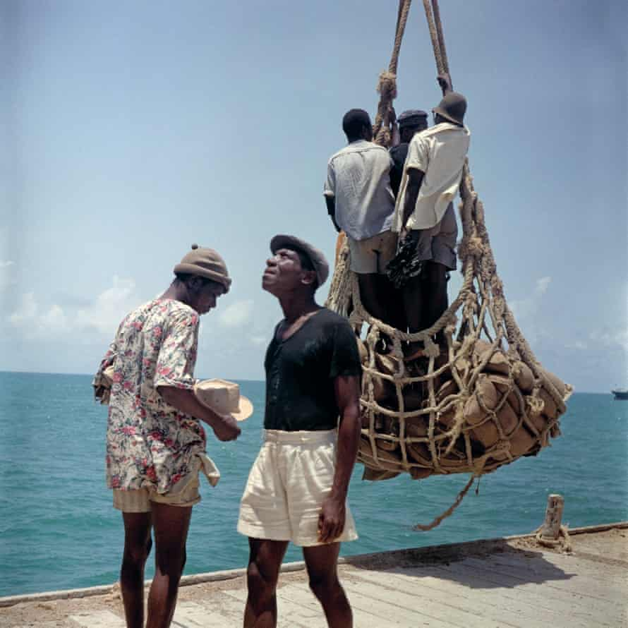 Loading people and goods at Lomé harbor in Togoland (now Togo).