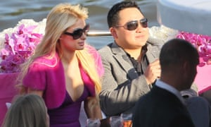 Jho Low with Paris Hilton at an event in Paris.