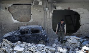 A man walks near the site of the chemical weapons attack in Douma, Syria