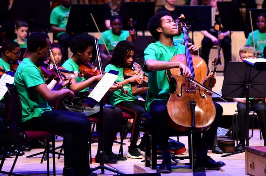 The cellist Sheku Kanneh-Mason performs at the 10th anniversary concert of the Royal Liverpool Philharmonic Orchestra's outreach programme In Harmony, 2019