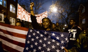 Demonstrators march in St Louis, Missouri, in November 2014 to protest the death of 18-year-old Michael Brown.