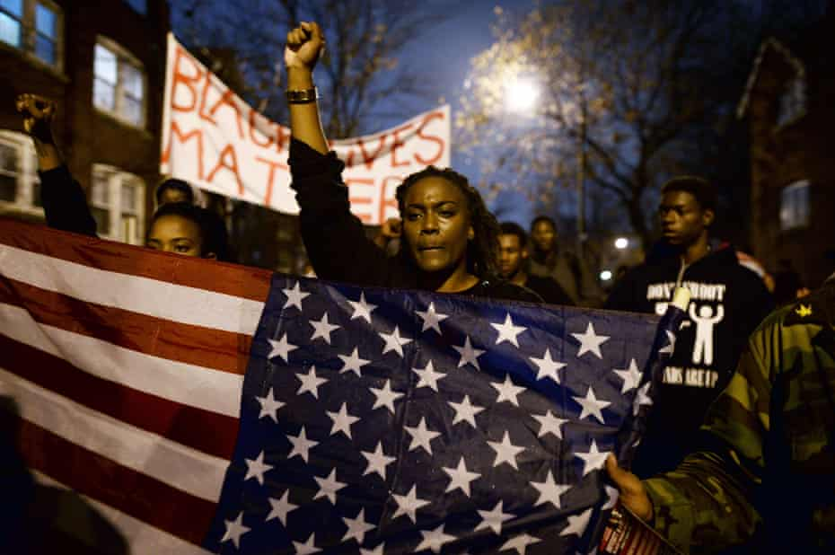 Demonstrators shout slogans during a march in St Louis, Missouri, on 23 November 2014 to protest the death of 18-year-old Michael Brown.