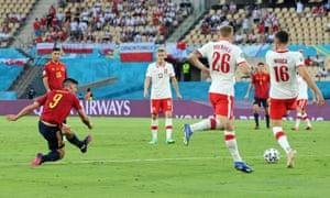 Spain's Gerard Moreno shoots before Alvaro Morata scores their first goal.
