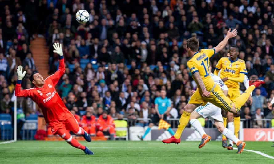 Mario Mandzukic heads the opening goal past Keylor Navas to launch Juventus's remarkable fightback.