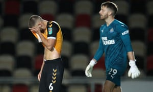 Newport County's Brandon Cooper (centre) reacts after missing during a penalty.