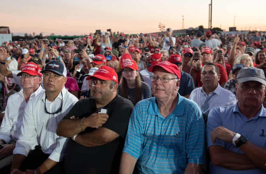 Attendees listen to Donald Trump speak at his campaign rally in Sanford, Florida.