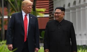North Korea's leader Kim Jong Un (R) walks with US President Donald Trump (L) at their historic US-North Korea summit, at the Capella Hotel on Sentosa island in Singapore in June.