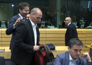 Eurogroup President Jeroen Dijsselbloem (L) greets Greek Finance Minister Yanis Varoufakis (C) during a Eurozone finance ministers emergency meeting on the situation in Greece in Brussels, Belgium June 25, 2015. Greece's international creditors gave Athens an ultimatum to come up with a credible reform plan on Thursday warning they would otherwise put their own proposals to euro zone finance ministers for approval, a euro zone official said. REUTERS/Philippe Wojazer