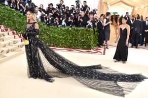 Rita Ora made a dramatic entrance at the Met Gala wearing a sweeping black Prada gown