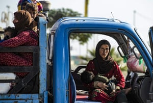 Syrian families flee the conflict between Turkish-led forces and Kurdish fighters from the Syrian Democratic Forces.