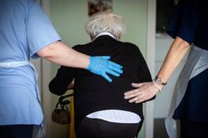 Resident Jane Ross using a walker