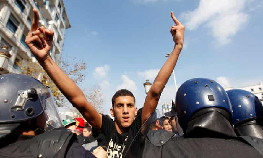 A pro-government protester at a demonstration in Algiers, February 2011.