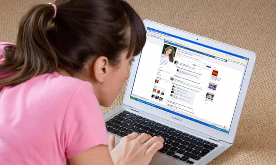 Woman looking at Facebook website on a laptop
