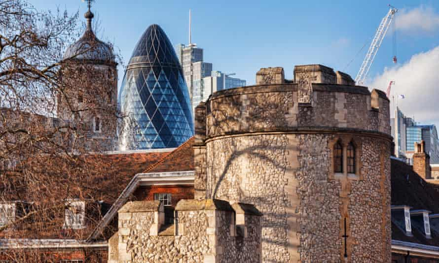 The Tower of London overlooked by 30 St Mary Axe, AKA the Gherkin.