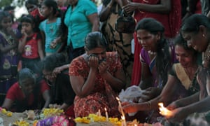 Tamil women at the grave of their relatives