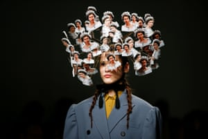 A model presents a creation adorned with images of Queen Elizabeth II during the pushButton catwalk show during fashion week in London, UK