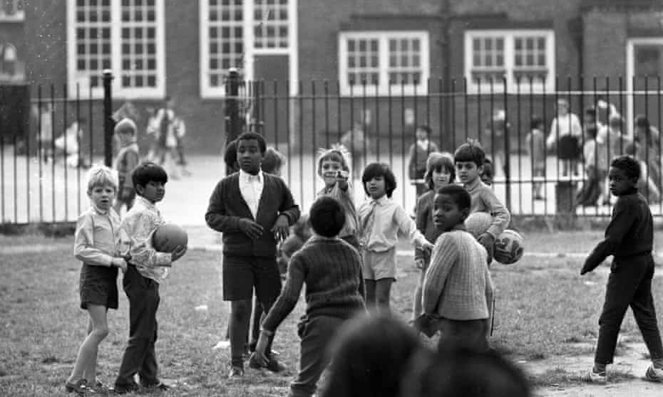 School children playing together in Southall, London, in 1972.