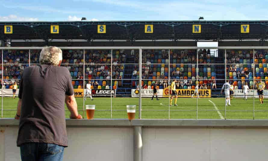 A Chmel Blsany fan watches his club play against against Liberec in the first division in May 2005.