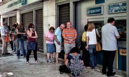 People wait in line to withdraw €60
