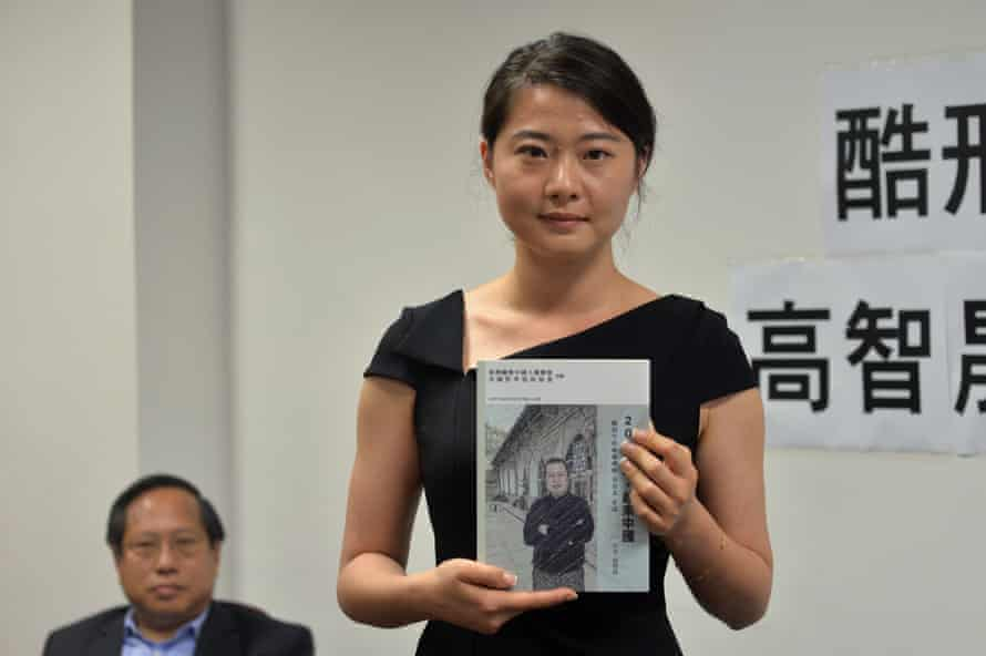 Grace Geng holds her father Gao Zhisheng's book at a press conference in Hong Kong.
