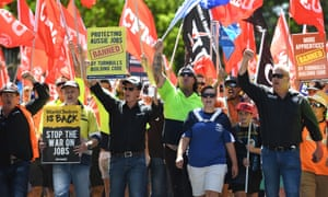 Workers are seen during a union protest against the slashing of penalty rates and the federal Government's tough new building code