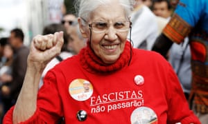A supporter of presidential candidate Fernando Haddad of the Workers' party gestures as she wears a T-shirt that reads: 'Fascists shall not pass'.