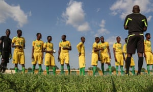 The El-Kanemi Warriors, the local football team, prepare to play after years kept off the pitch due to security concerns.