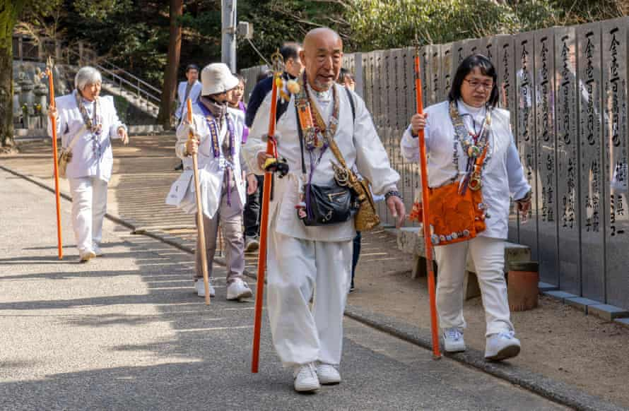 Buddhist pilgrims dressed in white walk
