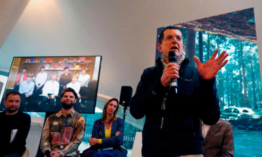 Antony Gormley speaking at the project's launch at the Serpentine Gallery in London, with BTS connected by video link.