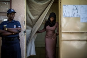 Banjul, The Gambia: A woman leaves her voting booth