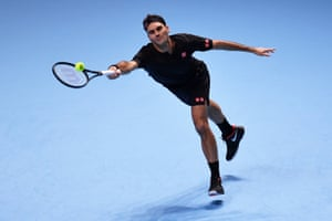 Roger Federer of Switzerland stretches to play a forehand.