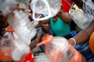 Migrants request water from nuns in Tapachula, Mexico