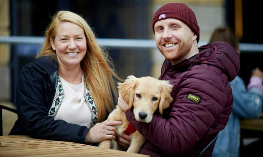 Lucy Andrews and Paul Swann with their dog in Stockport