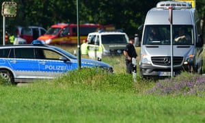 Emergency services attend the crash site of Eurofighter Typhoon jets near the village of Nossentin in Germany