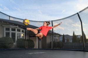 Annalie Longo, midfielder for Melbourne Victory and New Zealand, trains on a trampoline in her backyard in Christchurch.