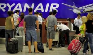 Ryanair passengers check in their bags