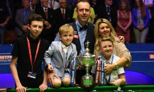 Mark Williams celebrates with his partner and children.